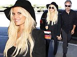 Los Angeles, CA - Jessica Simpson and husband Eric Johnson make their way past the paparazzi as they get set to fly out of town.  Jessica was full of smiles dressed in all black and holding Eric's hand.\nAKM-GSI       September  7, 2015\nTo License These Photos, Please Contact :\nSteve Ginsburg\n(310) 505-8447\n(323) 423-9397\nsteve@akmgsi.com\nsales@akmgsi.com\nor\nMaria Buda\n(917) 242-1505\nmbuda@akmgsi.com\nginsburgspalyinc@gmail.com