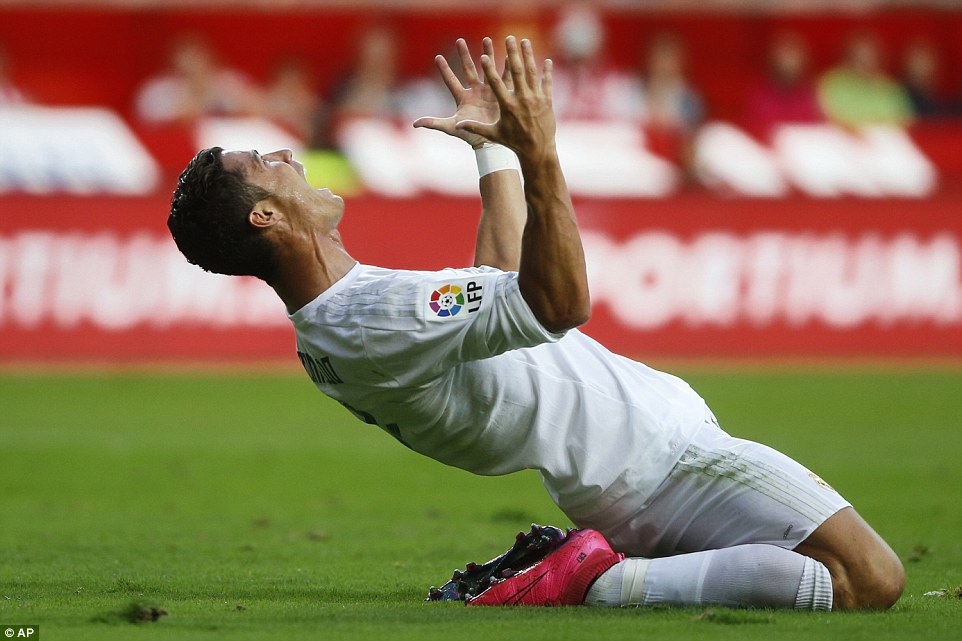 Cristiano Ronaldo vents his frustration after having a penalty appeal turned down in the first half of his side's draw with Sporting Gijon