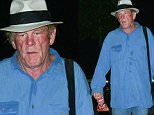 Nick Nolte looks haggard and worn while leaning on his cane at the Malibu Carnival. Nolte was sporting baggy jeans and an oversized, sweat-stained button up. September 6th., 2015. \nX17online.com