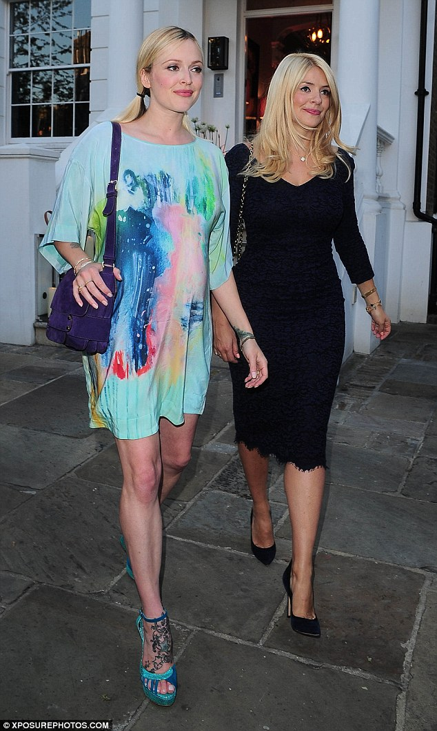 Cute duo: The television presenter pair looked ready to party on a balmy summer's evening