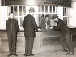 Customers at the counter of the London Joint City and Midland Bank.