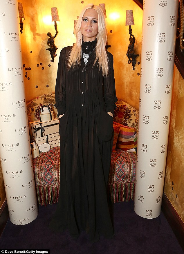Woman in black: The event was a meeting of high-fashion minds as Poppy Delevingne, the sister of Cara, made an appearance in a gothic black maxi dress which contrasted perfectly with her shock of blonde hair