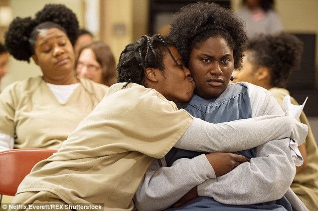 Loved up and not liking it: Adrienne, left, and Daniele, right with Uzo Aduba in a scene from Season 3 of the hour-long dramedy . Season 4 will be released in its entirety next June