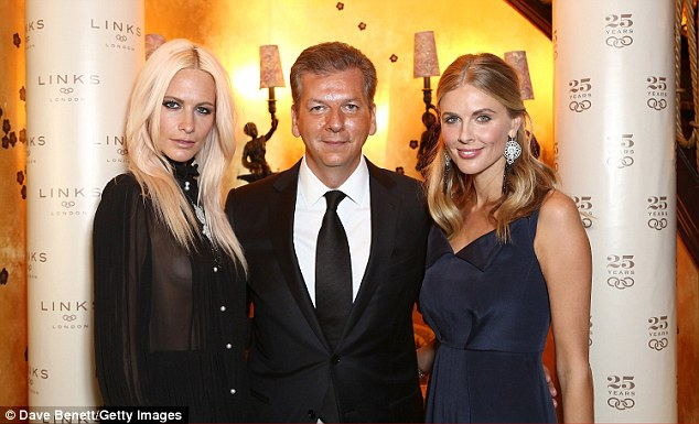 In good company: Poppy posed with Mr Koutsolioutsos and Donna Air