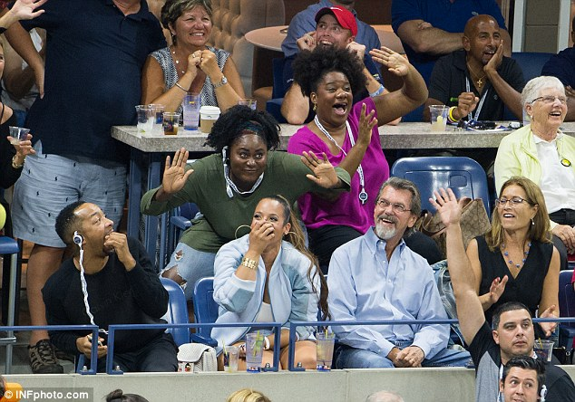 Having a laugh: The trio watched top-seeded Novak Djokovic beat Roberto Bautista Agut in four sets at the Arthur Ashe Stadium in the USTA Billie Jean King National Tennis Center in Flushing, Queens, New York