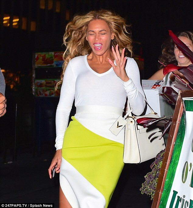Blinded: The bright camera flashes had Mrs. Carter quite surprised