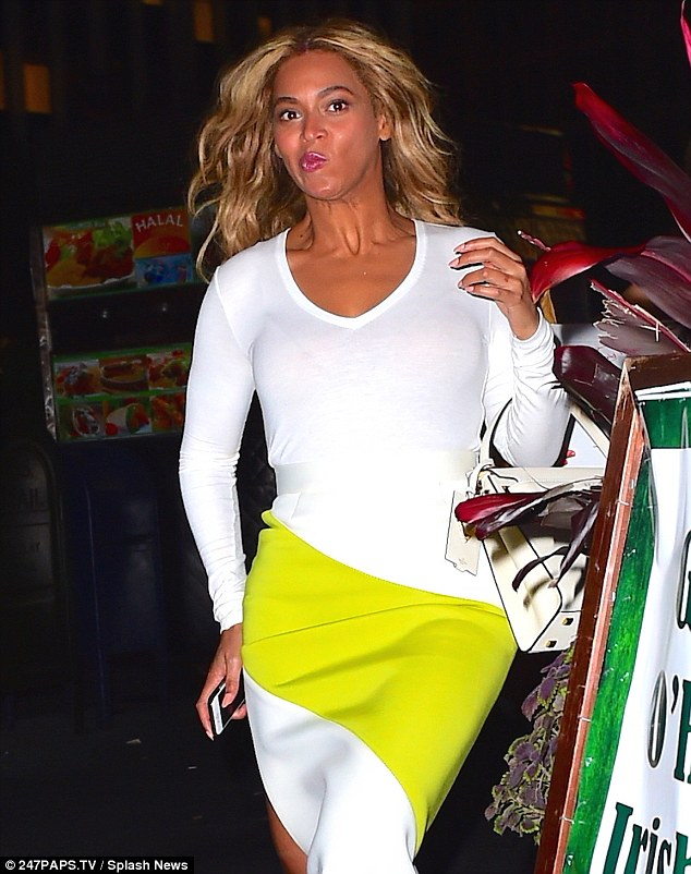 Caught off guard: Beyonce pulled some funny faces while leaving an office building in New York on Monday night