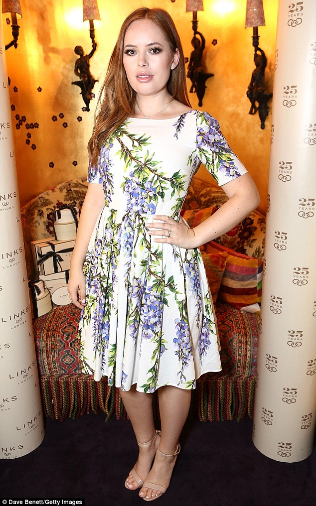 Floral bouquet: Newlywed vlogger Tanya Burr seemed to have missed the punky, gothic memo of the night as she rocked an extremely prim, prom-style dress adorned with a floral pattern