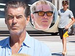 EXCLUSIVE TO INF.\nSeptember 6, 2015: Pierce Brosnan enjoys a day of shopping with his son, Paris Brosnan, at a surf shop in Malibu, California. The 62-year-old actor picks up some straw hats and a GoPro camera, while his 14-year-old son walks out carrying a new surfboard.\nMandatory Credit: Borisio/SAA/INFphoto.com\nRef: infusla-277/301