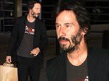 """Los Angeles, CA - Keanu Reeves arrives back in L.A. after attending the Deauville Film Festival in France to promote his new film """"Knock Knock"""".  Keanu wasn't in the mood to see cameras, holding up his hand to cover his face.\nAKM-GSI          September 6, 2015\n \n To License These Photos, Please Contact :\n \n Steve Ginsburg\n (310) 505-8447\n (323) 423-9397\n steve@akmgsi.com\n sales@akmgsi.com\n \n or\n \n Maria Buda\n (917) 242-1505\n mbuda@akmgsi.com\n ginsburgspalyinc@gmail.com"""