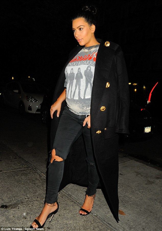 Grand arrival: Kim's expression-filled face hinted at her excitement as she made her way to the restaurant
