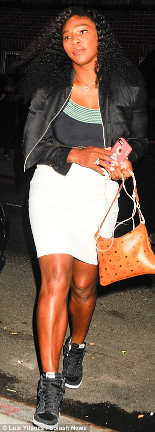 Thighly impressive: Serena showed off her tennis player's legs in a mini skirt and trainers combo