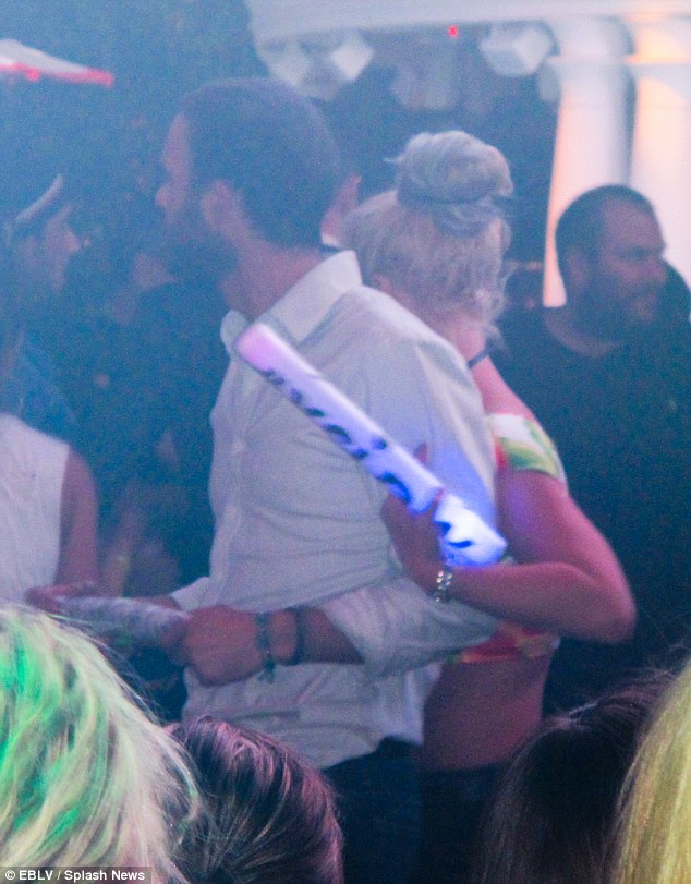 Bear Hug: Britney gets hands on as she parties in Vegas with Cade Hudson in the DJ Booth Vip Table at XS Nightclub in Las Vegas on Friday night