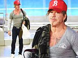 EXCLUSIVE: Mickey Rourke arrives at JFK airport in NYC.\n\nPictured: Mickey Rourke\nRef: SPL1118101  060915   EXCLUSIVE\nPicture by: Ron Asadorian / Splash News\n\nSplash News and Pictures\nLos Angeles: 310-821-2666\nNew York: 212-619-2666\nLondon: 870-934-2666\nphotodesk@splashnews.com\n
