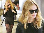 Los Angeles, CA - Beautiful actress Heather Graham shows off her killer bod upon arrival at LAX.  The pretty blonde wore an all black outfit consisting of black fishnet stockings paired with black shorts and a matching sweater. \nAKM-GSI         September 6, 2015\nTo License These Photos, Please Contact :\nSteve Ginsburg\n(310) 505-8447\n(323) 423-9397\nsteve@akmgsi.com\nsales@akmgsi.com\nor\nMaria Buda\n(917) 242-1505\nmbuda@akmgsi.com\nginsburgspalyinc@gmail.com