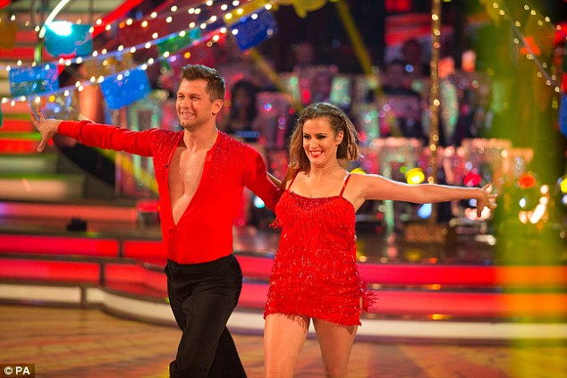 Strutting her stuff: Strictly Come Dancing's reigning champion Caroline Flack took to the dance floor to perform a sassy dance routine alongside dance partner Pasha Kovalev during Saturday night's show