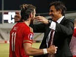 Football - Cyprus v Wales - UEFA Euro 2016 Qualifying Group B - GSP Stadium, Nicosia, Cyprus - 3/9/15  Wales' Gareth Bale celebrates with manager Chris Coleman at the end of the match  Action Images via Reuters / Andrew Boyers  Livepic  EDITORIAL USE ONLY.