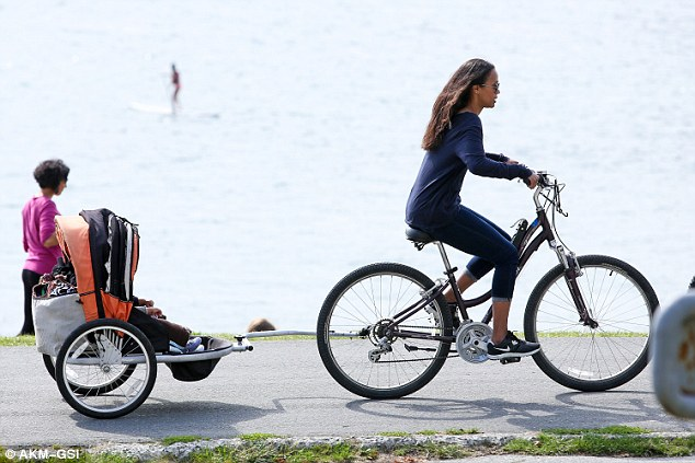 Fresh air: The actress who's in the city to film Star Trek Beyond towed her nine month old twin sons Bowie and Cy behind her as she rode around the seawall path int he park