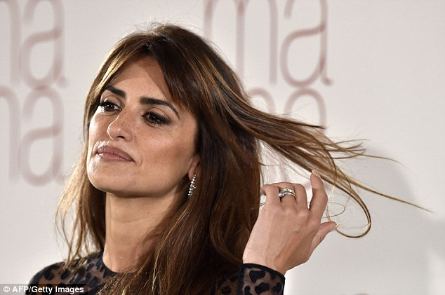 Flawless: Her highlighted brunette locks were worn in a straight style, while her side-swept fringe made sure to delicately frame her pretty face which had been enhanced with a smokey eye-shadow look and a nude lipstick