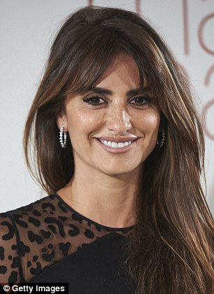 Bling bling: The Vicky Cristina Barcelona star complimented the look with a pair of skyscraper black stilettos and hooped  diamond earrings