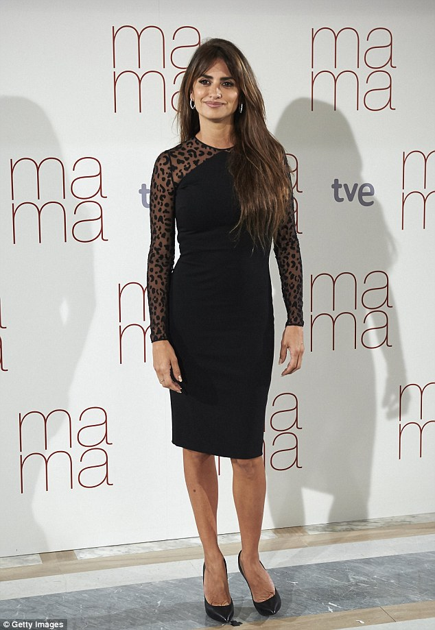 Animalistic: Penelope Cruz showed off her wild side in a black mesh dress whilst attending the photocall for her new movie Ma Ma at the Villamagna Hotel in her native Madrid, Spain, on Monday