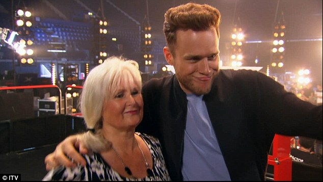 Mini me: With Jamie's mum waiting backstage with the real Olly, the X Factor host began to question what Cheryl meant by her comments, as he asked 'what's so wrong with being compared to me?'