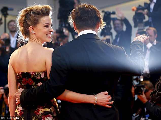 Excitable: Amber grinned with happiness as she relished in the red carpet moment with her husband