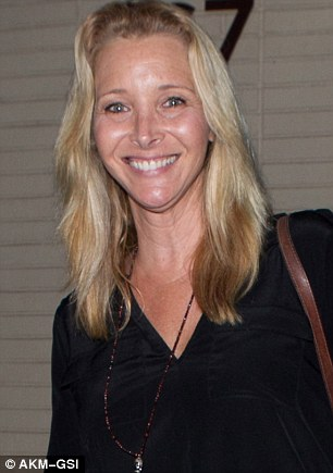 Still hot after two decades:Lisa Kudrow seemed to be in great spirits after a dinner date with spouse Michel Stern, at The Palm in Beverly Hills on Sunday evening