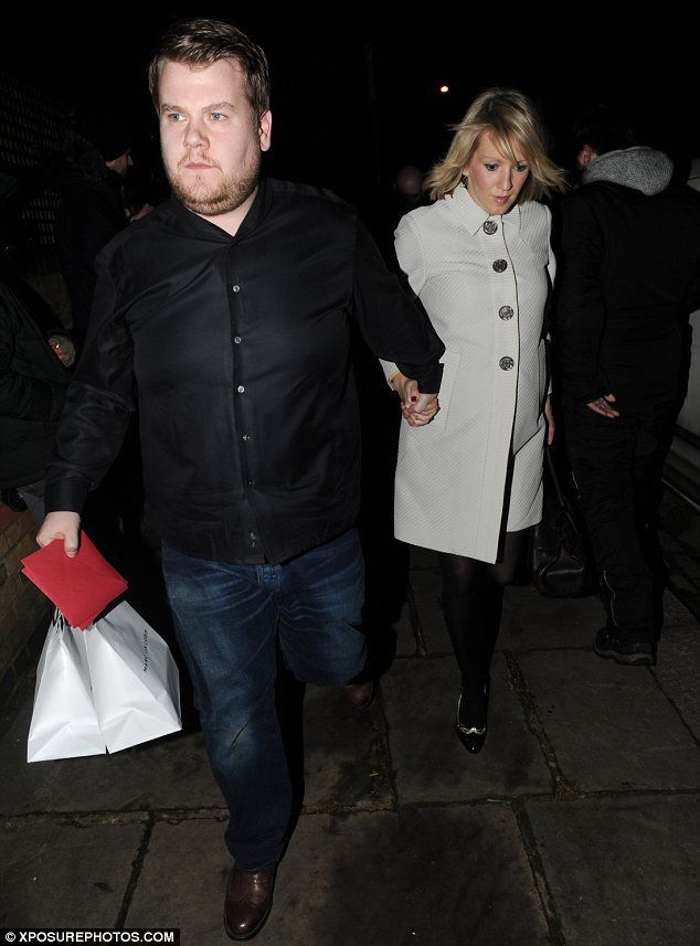 Posh presents: James Corden arrives with girlfriend Julia Carey carrying two Marc Jacobs gift bags
