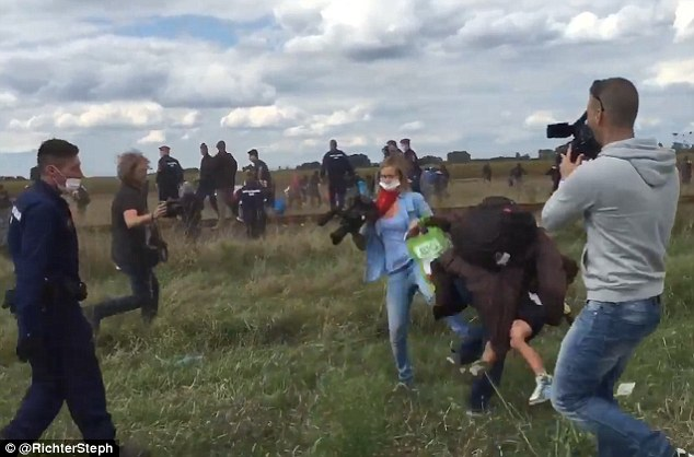 Hungarian camerawoman Petra Laszlo has been caught kicking and tripping over migrants as they escaped from police officers who were making them wait on the border between Hungary and Serbia