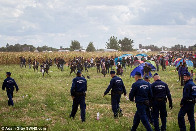 The scene was chaotic at times, with police choosing not to stop many of the migrants running away
