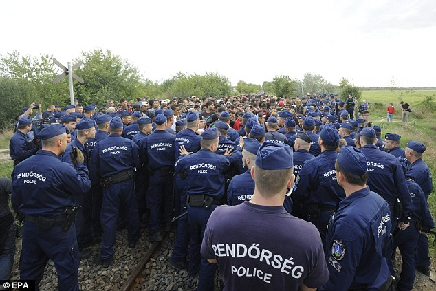 Dozens of police circled around the migrants they managed to catch to prevent them getting any further away from the registration centre
