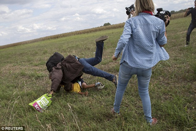 The man was caught off guard and landed heavily with the child underneath him while the woman continued to watch