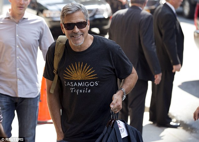 George Clooney will be among the first guests for the debut of talk show host Stephen Colbert's arrival at The Late Show Tuesday night. Above, the actor outside the Ed Sullivan Theater
