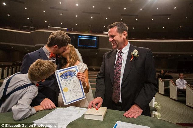 Showing off: Jessa and Ben kiss as they display their marriage certificate