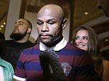 Floyd Mayweather Jr. speaks with the media during a grand arrival for his upcoming fight Tuesday, Sept. 8, 2015, in Las Vegas. Mayweather is scheduled to fight Andre Berto in a welterweight title bout Saturday in Las Vegas. (AP Photo/John Locher)