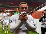 An emotional Rooney walks down the tunnel after surpassing Sir Bobby Charlton's 45-year-old scoring record at Wembley