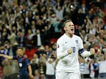 Englandís Wayne Rooney celebrates after scoring his side's second goal during the Euro 2016 Group E qualifying soccer match between England and Switzerland at Wembley stadium in London, England, Tuesday, Sept. 8, 2015 . Rooney scored his 50th international goal to top England's all time goal scorers at this level. (AP Photo/Frank Augstein)
