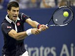 Novak Djokovic of Serbia hits the ball to Feliciano Lopez of Spain during their quarterfinal match at the U.S. Open Championships tennis tournament in New York, September 8, 2015.       REUTERS/Carlo Allegri