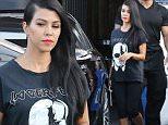 Kourtney Kardashian wearing super cool Lagerfeld tee shirt and bright lips at the studio September 8, 2015 X17online.com