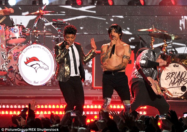 Success: The Just The Way You Are singer's performance with the Red Hot Chili Peppers in 2014 (pictured) was the most-watched half-time show ever with a staggering 115.3 million viewers - until it was beaten by Katy Perry earlier this year