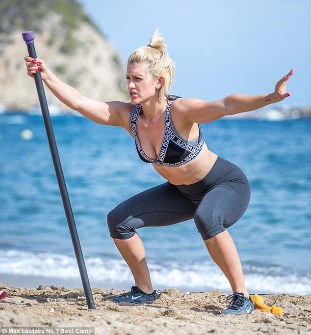 Tone up: The pretty blonde was seen flexing her muscles and pulling a few stretches as well as doing a few swats under the balmy climes beside the sea