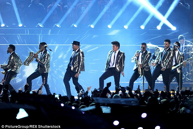 Family show: His universal appeal and old school style is thought to be perfect for the Super Bowl's golden anniversary at Levi Stadium on February 7th 2016 (pictured in 2014)