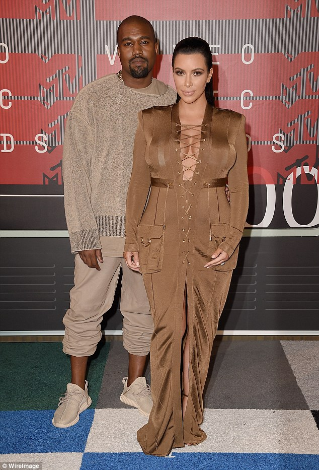 Power couple: Kanye West and wife Kim Kardashian, who represent 'corporate synergy', also made their collective debut on the list at number 12