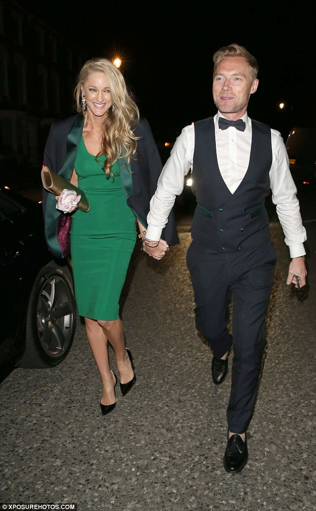Newlyweds: Ronan Keating was all smiles as he arrived with new wife Storm, who looked ravishing an emerald dress