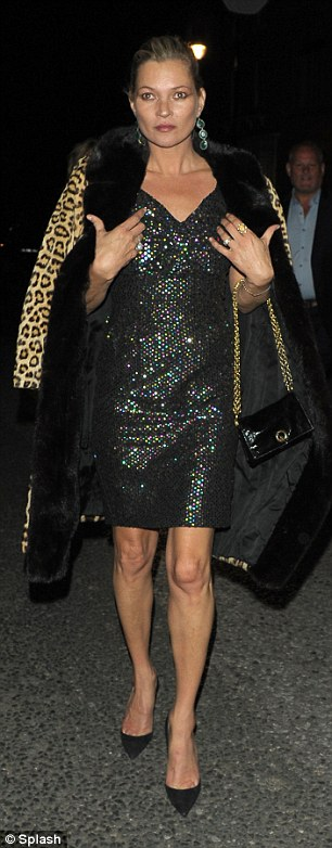 Is she fur real? For an added touch of glamour, the supermodel threw a leopard print coat over her shoulders