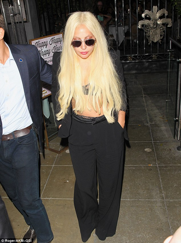 Mermaid: The Poker Face hit-maker was clad entirely in black with her platinum blonde locks falling round her shoulders