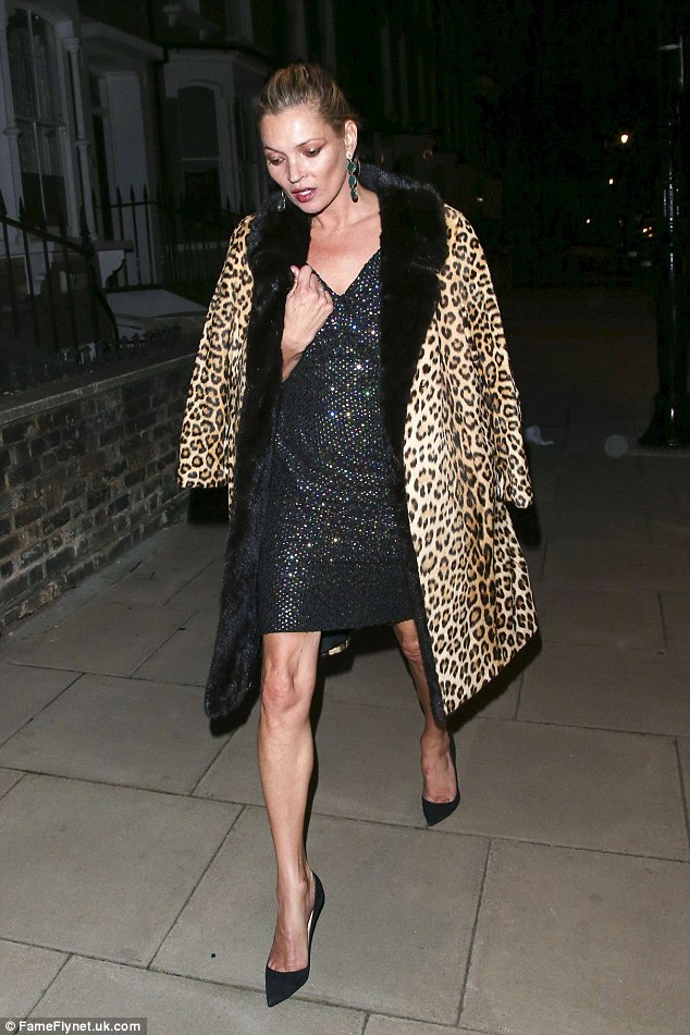 Fashionably late: Just hours earlier, the supermodel strutted into the GQ Awards afterparty in the same coat