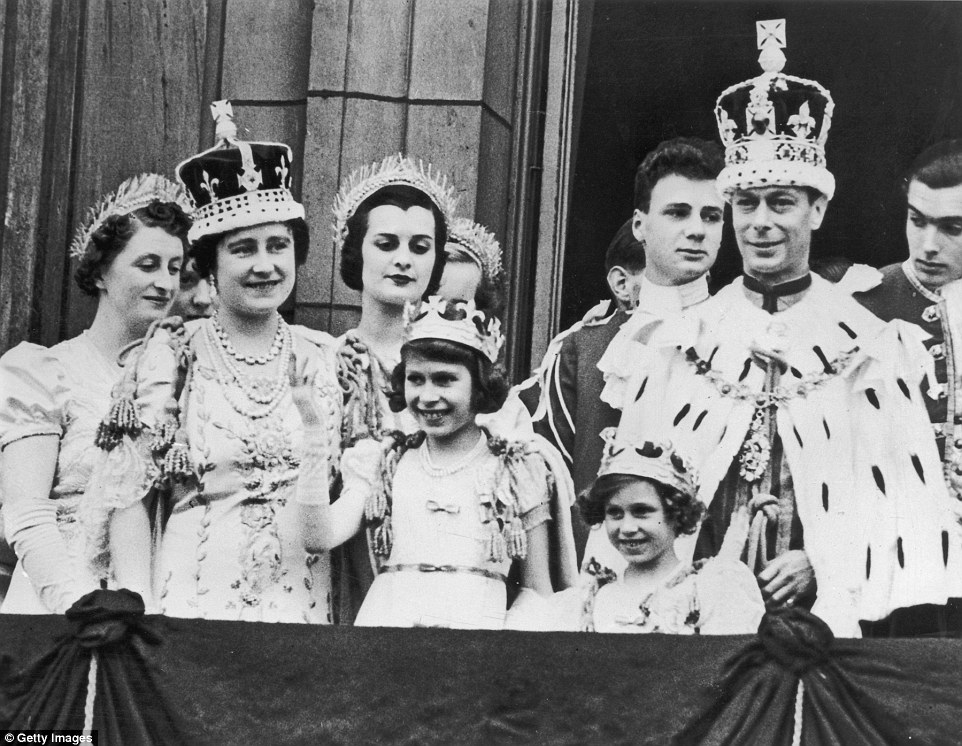 Sharing: Some of the Queen's red boxes are inherited from George VI, pictured here with his family at his coronation in 1937