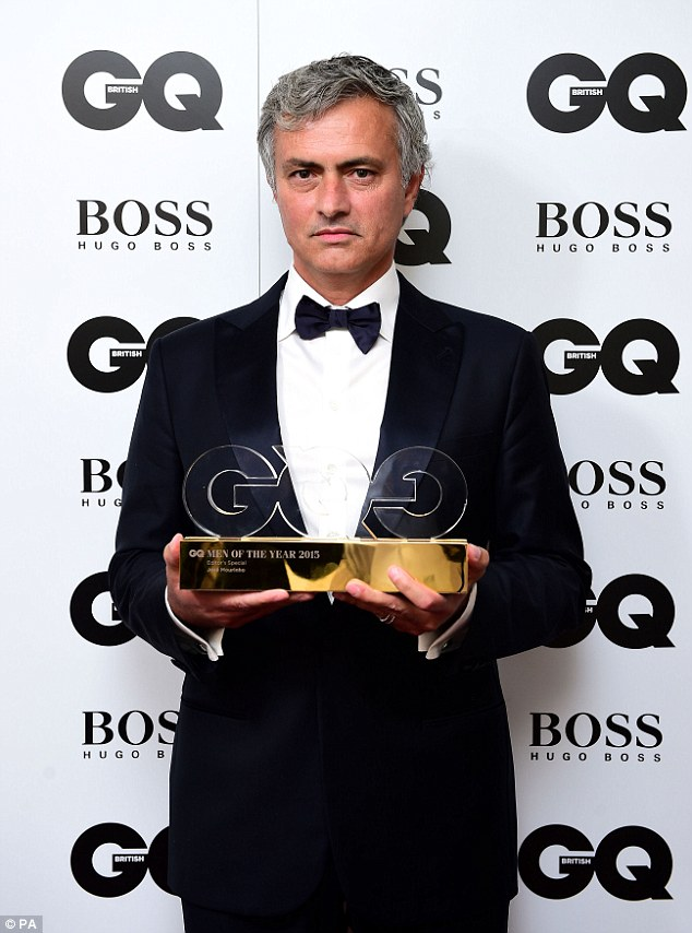 Time to celebrate: He looked delighted as he clutched his award